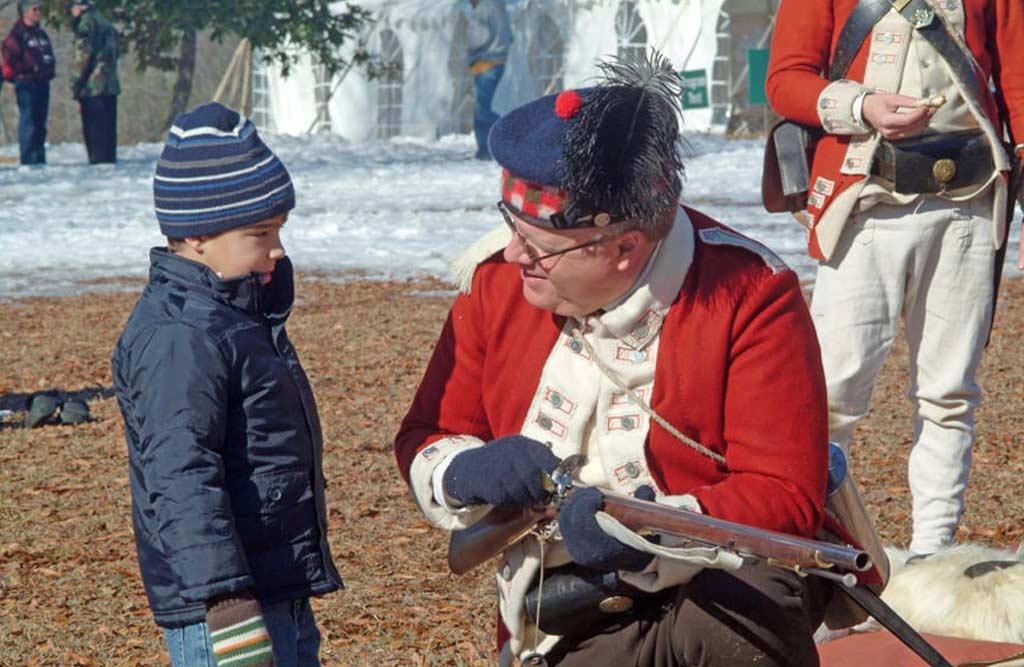 Cowpens battle reenact talking to little boy